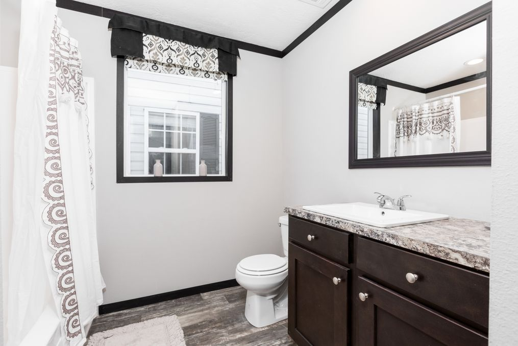 The THE FRANKLIN XL Guest Bathroom. This Manufactured Mobile Home features 4 bedrooms and 2 baths.