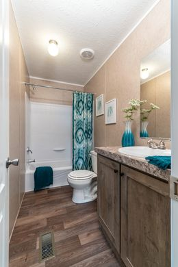 The THE EAGLE 60 Guest Bathroom. This Manufactured Mobile Home features 3 bedrooms and 2 baths.