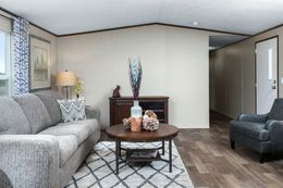 The VICTORY PLUS Living Room. This Manufactured Mobile Home features 3 bedrooms and 2 baths.