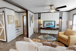 The BREEZE FARMHOUSE 72 Living Room. This Manufactured Mobile Home features 4 bedrooms and 2 baths.