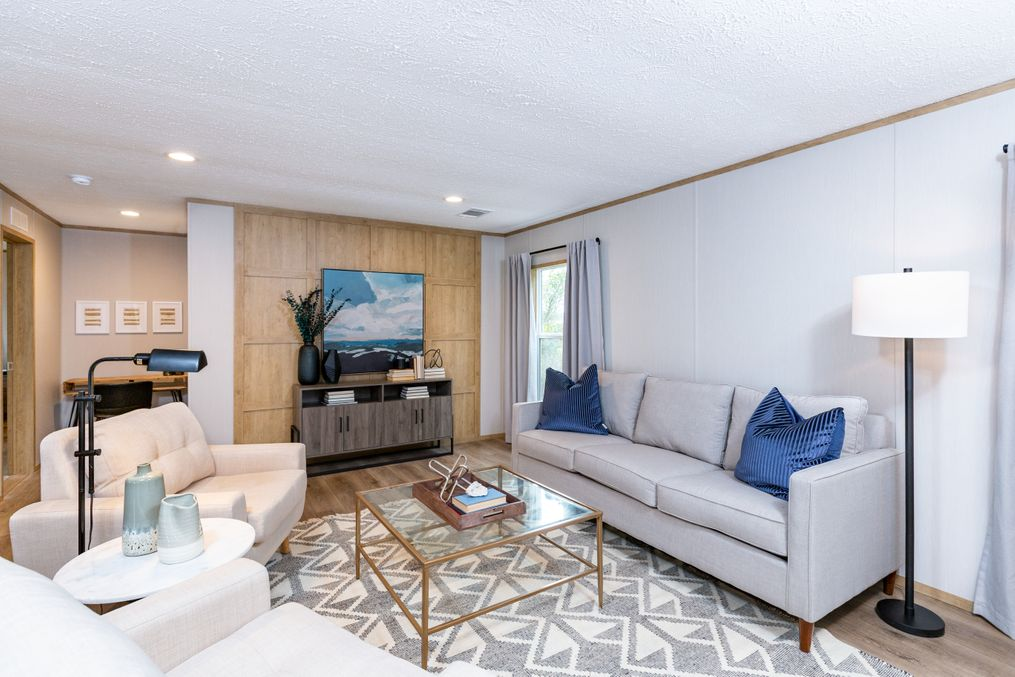 The EVEREST Living Room. This Manufactured Mobile Home features 4 bedrooms and 2 baths.