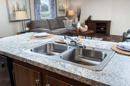 The VICTORY PLUS Kitchen. This Manufactured Mobile Home features 3 bedrooms and 2 baths.