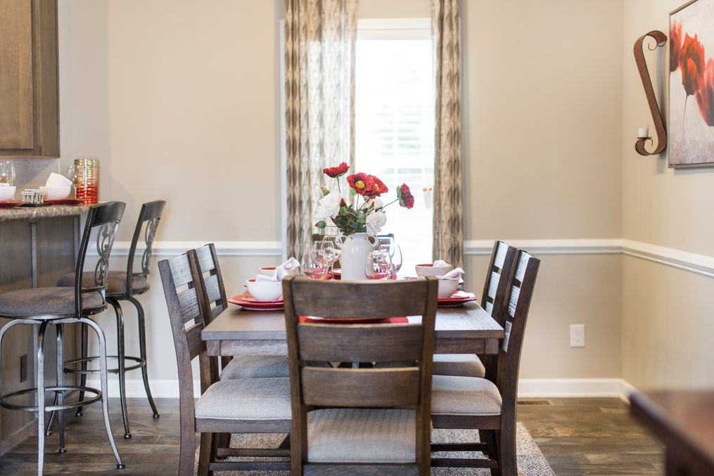 The 3328 CLASSIC Dining Area. This Manufactured Mobile Home features 4 bedrooms and 2 baths.