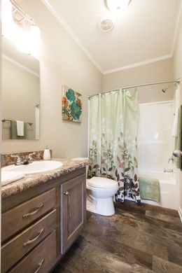 The 3328 CLASSIC Guest Bathroom. This Manufactured Mobile Home features 4 bedrooms and 2 baths.
