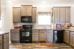 The 3328 CLASSIC Kitchen. This Manufactured Mobile Home features 4 bedrooms and 2 baths.