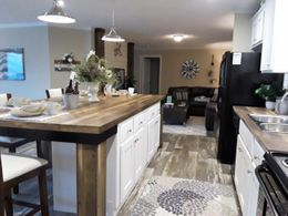 The ANSWER M375 Kitchen. This Manufactured Mobile Home features 4 bedrooms and 2 baths.