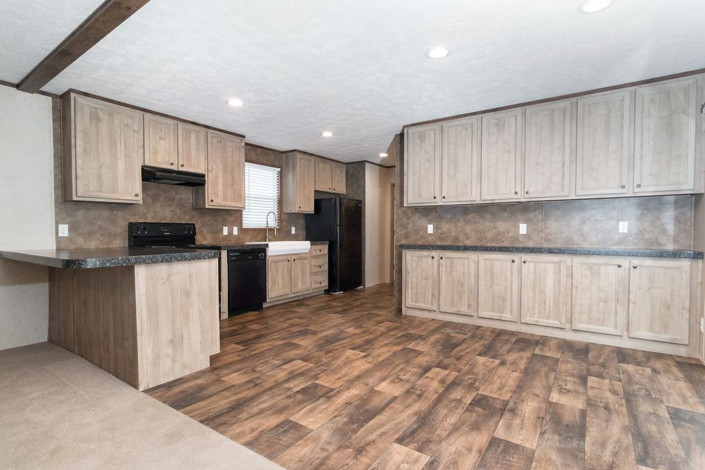 The THE ANNIVERSARY 18 4 BR Kitchen. This Manufactured Mobile Home features 4 bedrooms and 2 baths.