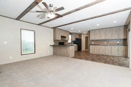 The THE ANNIVERSARY 18 4 BR Living Room. This Manufactured Mobile Home features 4 bedrooms and 2 baths.