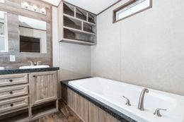 The THE ANNIVERSARY 18 4 BR Master Bathroom. This Manufactured Mobile Home features 4 bedrooms and 2 baths.